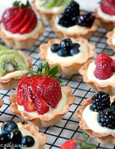 I love eating these when out at a buffet or event. Probably dangerous to learn how to make them. fruit and cream mini-tarts