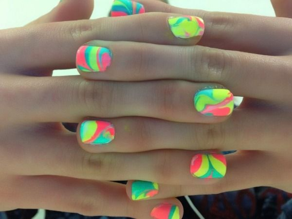 Need: bowl of water, tape, many nail colors!  Drop drops of nail polishes in bowl of water, put tape on skin around finger nail, dip nails in, and voila! Rainbow nails! Saw this on macbarbie08 :)