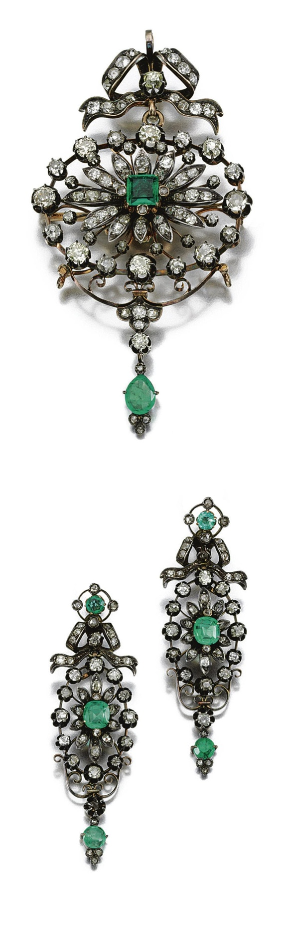 EMERALD AND DIAMOND DEMI-PARURE, LATE 19TH CENTURY.   Comprising: a brooch and pair of earrings of open work floral design set with emeralds and diamonds of various shapes, brooch with detachable surmount and central emerald and diamond section, pendant earrings each with detachable surmounts, later fittings.
