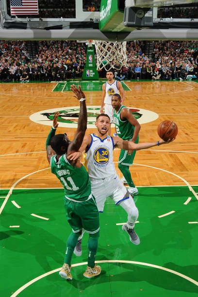Stephen Curry of the Golden State Warriors goes to the basket against the Boston Celtics on November 16 2017 at the TD Garden in Boston Massachusetts...
