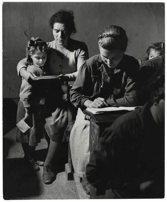 Women and girls reading in a school, Calabria, Italy 1950