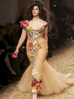 This is Crystal Renn.  She's a plus-size model.  I love her gown and I love the confidence she's exuding in this picture.