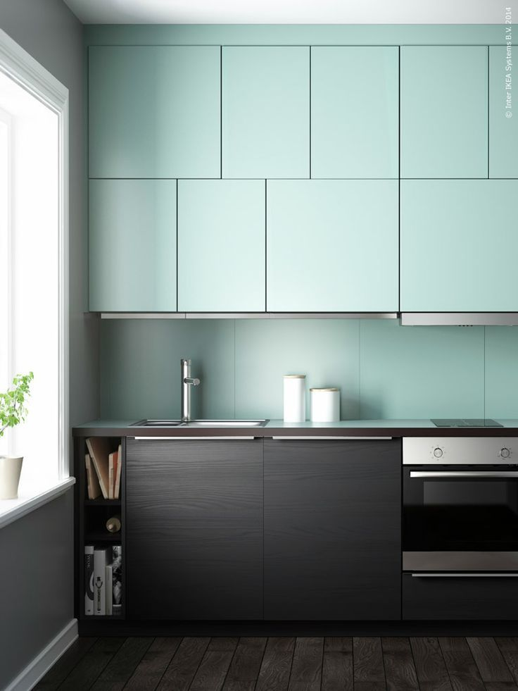 Retro mint meets sleek & modern dark wood cabinets and flooring. Incorporating mint accents in the kitchen reminiscent of the 50s with a modern twist is completely on trend.