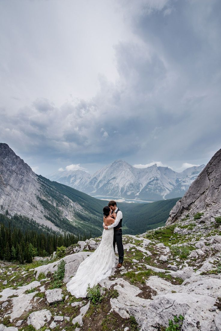 The bride and groom after their wedding ceremony at a hiking elopement in Kananaskis, near Canmore, Alberta in the Canadian Rockies. They had a fun, private mountain wedding surrounded by nature. Photo by one-edition.ca.