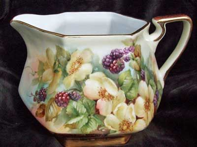 Porcelain pitcher painted by porcelain artist and teacher, Charlene Whitler