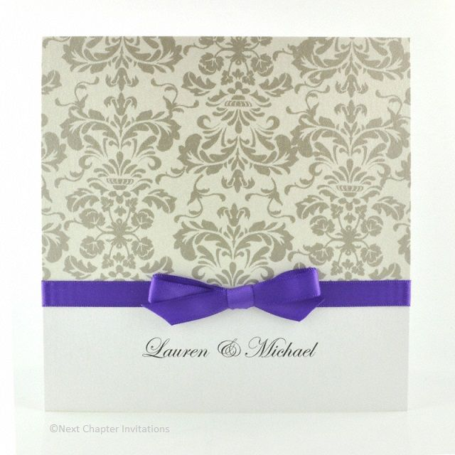 ELIZABETHAN  A gorgeous example of Victorian charm is captured with Florentine Silver brocade against a pearl card. It is finished with a regal purple ribbon and comes with a matching metallic pearl envelope. Price: $5.95 https://www.facebook.com/NextChapterWeddingInvitations