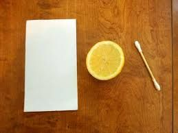 To write an invisible message, dip a toothpick or any other sharp object in lemon, milk, white wine, vinegar, apple juice or orange juice and write on the paper. Let it dry completely. To see the message, just hold it in front of a light bulb or candle flame (not too close). The heat of the bulb will make the message appear in brown color. Read more at Buzzle: http://www.buzzle.com/articles/spy-gadgets-for-kids.html