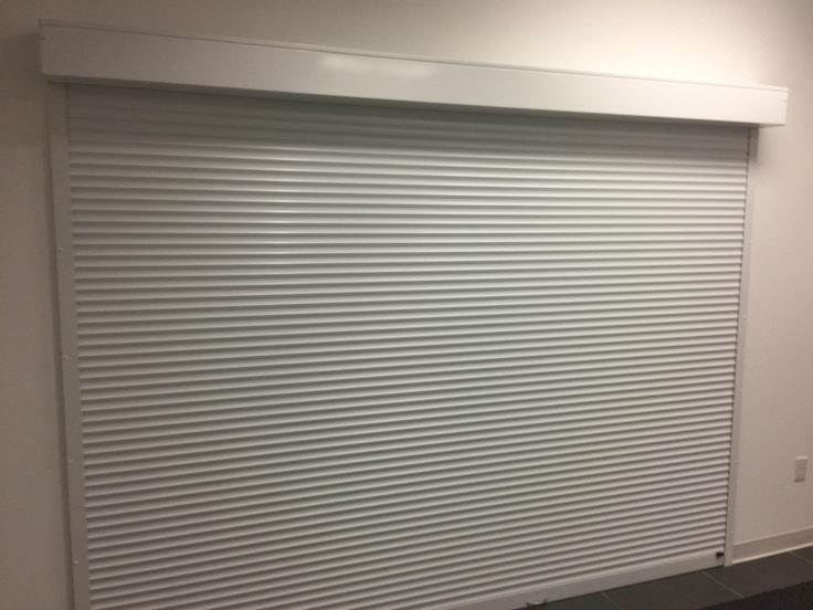 Looking to add privacy to a conference room, Rollok has the answer, add a rolling shutter. Wide selection of material to fit the space