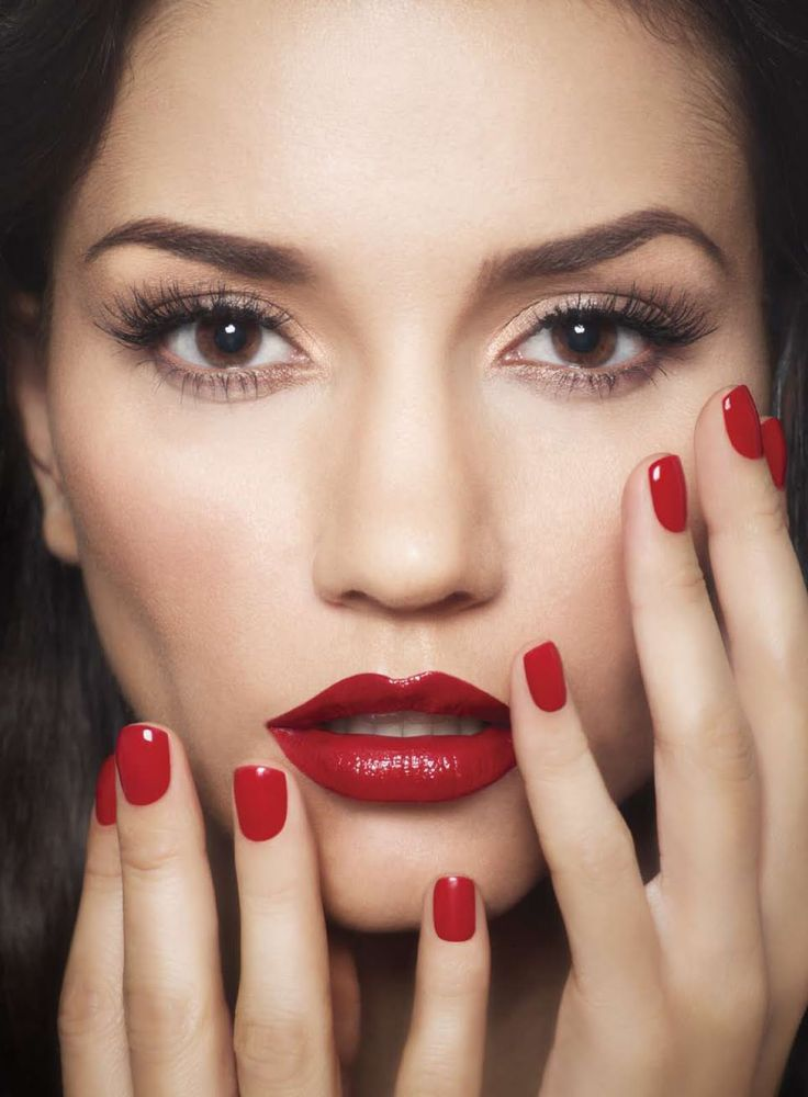 Red lipstick & nail polish against porcelain skin ...