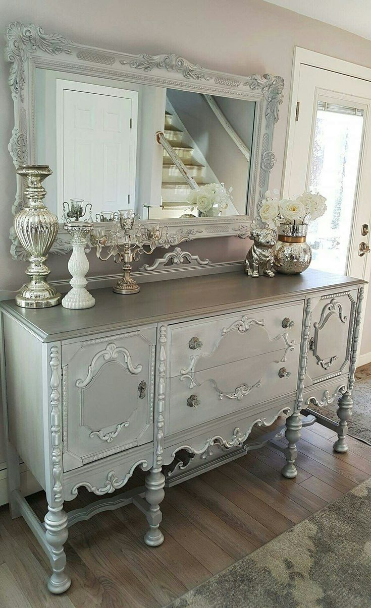 Side view of the vintage Jacobean buffet.  Mirror upcycled, repurposed and refinished. White and gray chalk painted, silver, dark glaze, gilding wax and glass crystal antiqued knobs to finish this one :) you can see more on my FB page. Chictoshabbyfurniturebyrebecca