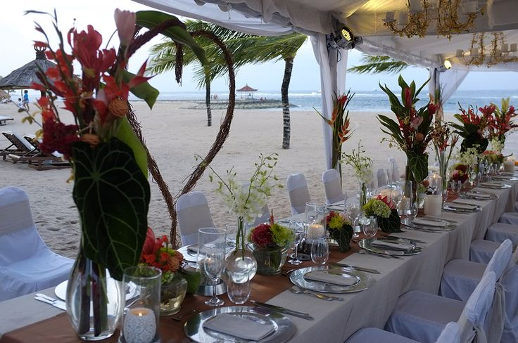 Tropical flame reds Reds with Belgiun linen Brown.  Rich elegant table scapes.