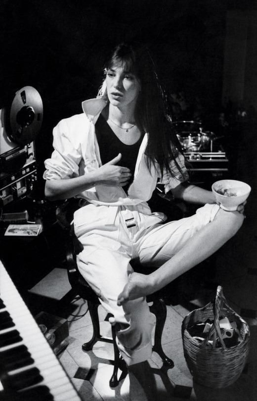 Jane Birkin sitting at Serge Gainsbourg's piano in their Rue de Verneuil house in Paris, 1970s (via Old Pics Archive on Twitter)
