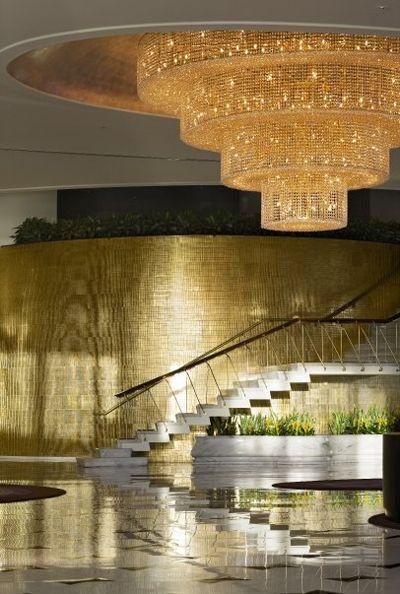 Morris Lapidus Fontainebleu Miami interior lobby staircase gold tile wall chandelier Miami Hotel Interior Designs