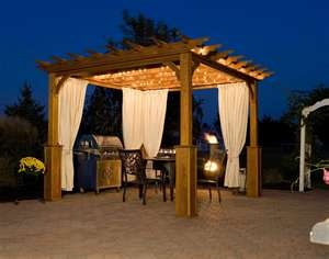 Pergola with curtains & lights - similar to what we want to do in the area with built-in seating