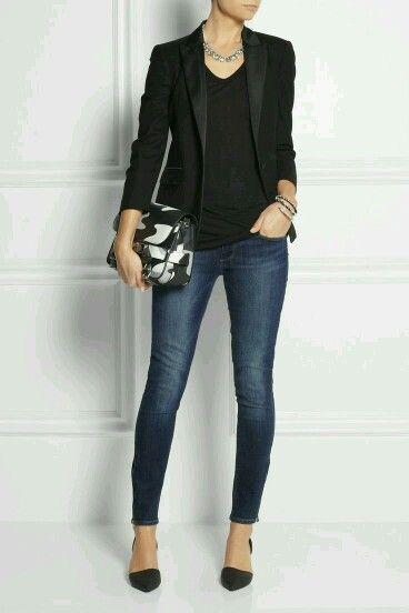 Black blazer with black shirt and dark jeans. Black stilettos