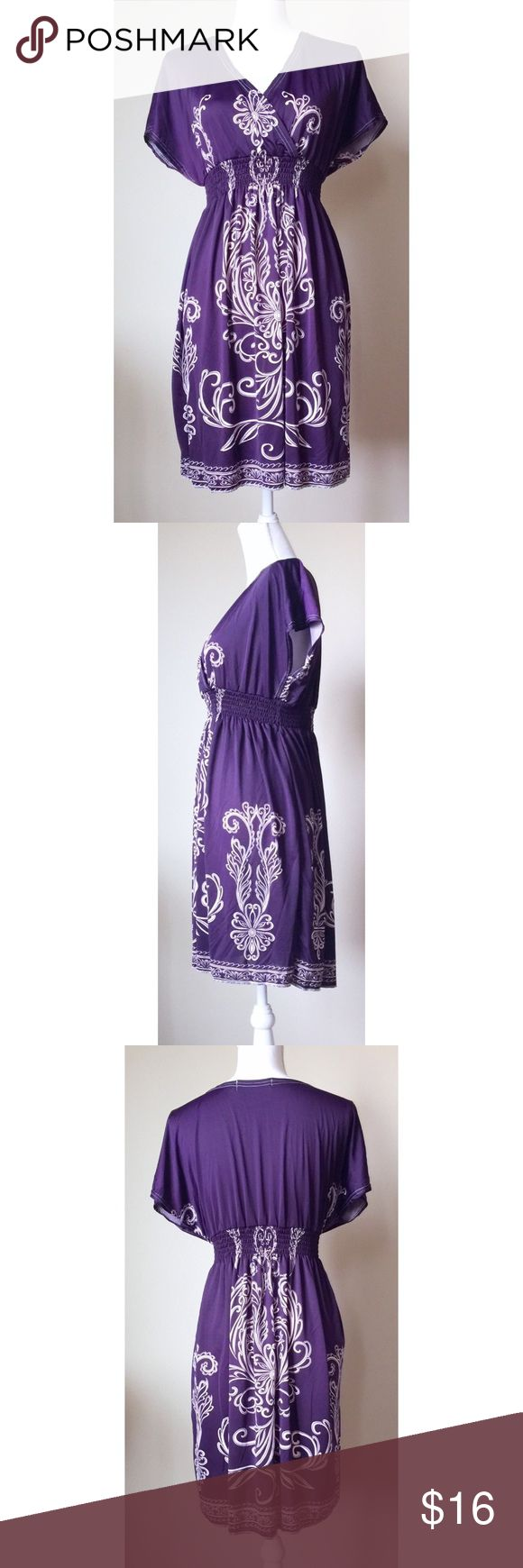 Gorgeous Wrap Front Dress NWOT.  Beautiful short sleeved wrap front dress.  Light weight and perfect for spring and summer. Dresses Midi