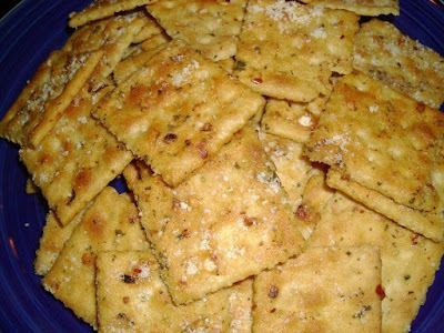 Ingredients:  1 1/2 sticks butter, melted  1 packet ranch dressing mix  2 T. red pepper flakes  1/2 tsp. garlic powder  2 sleeves saltine crackers  parmesan cheese    Instructions:    In a large bowl combine melted butter, dressing mix, pepper flakes, and garlic powder.  Add crackers, 1