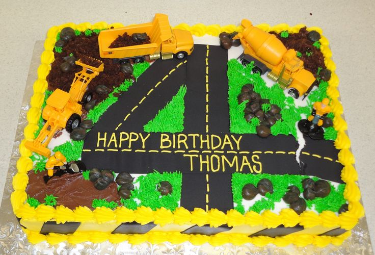 """Construction cake: meets all cake """"requirements"""" according to H: a road, the number 4, a cement truck, and a dump truck. Whew, I think that's it!"""