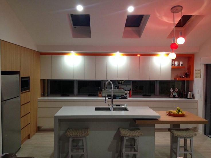60mm Quantum Quartz- Carrara, 2pac- Whisper White Satin, Laminex Sublime Teak Riven, Orange Gloss - Modern Living Kitchens & Cabinetry, Furniture Manufacturers, Southport, QLD, 4215 - TrueLocal