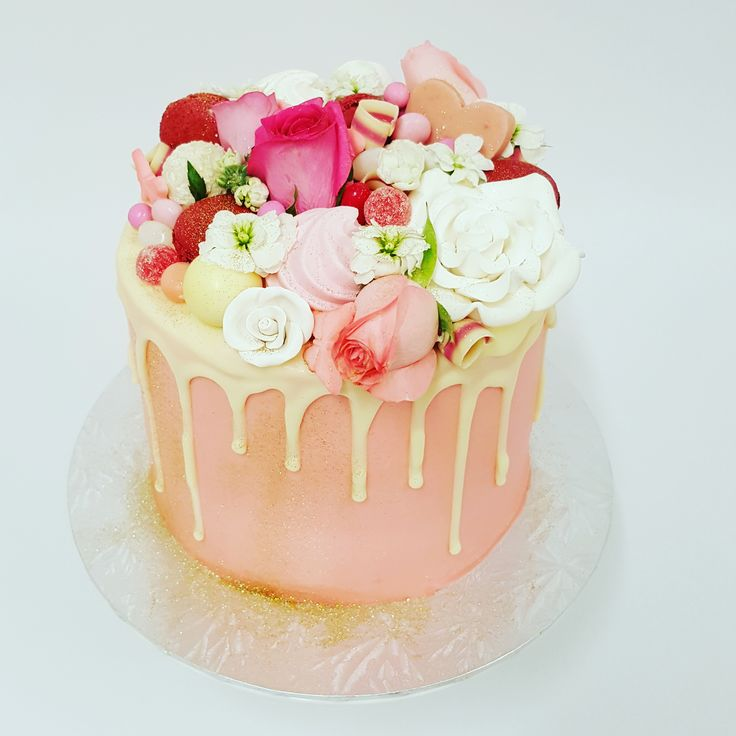 Round Pink with pink and white toppings