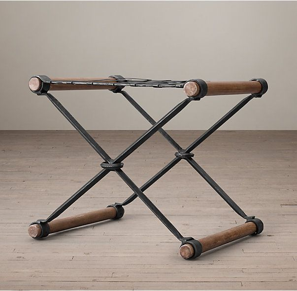 RH's Campaign Luggage Rack:Inspired by the practical, packable designs of traditional 19th-century Campaign furniture, our luggage rack is characterized by its distinctive X-shaped base and mix of wood and wrought iron.