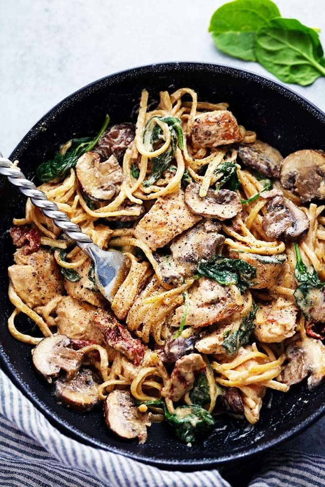 One Pot Creamy Chicken Pasta Dinner Recipe. This simple, easy weeknight meal is perfect for dinners for families! Cook up this quick, one pan dinner with chicken, mushrooms, spinach, sun-dried tomatoes, and linguine. Cheap, budget and inexpensive dinner recipes like this are great to have on hand whether you're cooking for family of two, four or more!