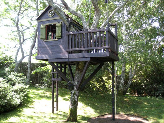 perfect tree house - great little deck, pole to slide down, interior chalkboard wall, ladder, and pulley with bucket.
