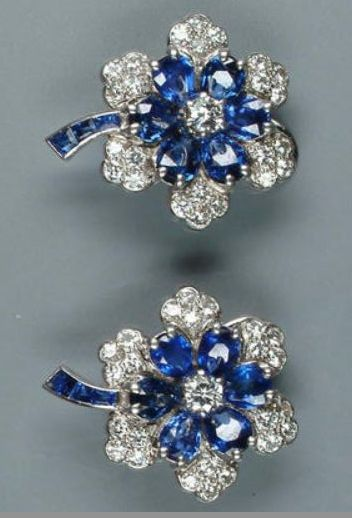 A pair of sapphire and diamond floral cluster earclips, by Cartier, circa 1935.
