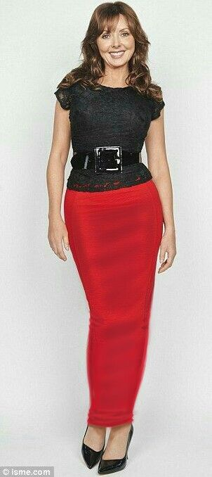 Carol Vorderman shows that she has  What it takes to wear a long tight poppy red hobble skirt !