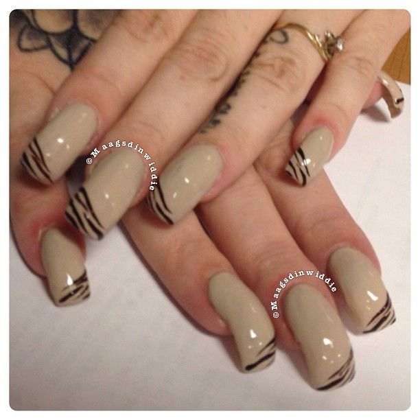 curved nails- THE ONLY REASON I PINNED THESE IS FOR THE NAIL ART. IT'S FREE HAND ART. I DON'T LIKE THE SHAPE OR THE NAIL POLISH COLOR ON THESE! -OMM