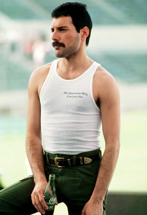 Freddie in South America, 1981. Photo by Neal Preston...the only thing as fabulous as the person in the pic is the coke in glass bottle that he's holding!