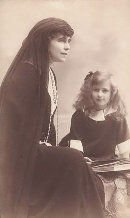 Queen Marie (1875-1938) and Princess Ileana (1909-1991) of Romania. Probably in mourning for her uncle-in-law King Carol I of Romania who died in 1914.