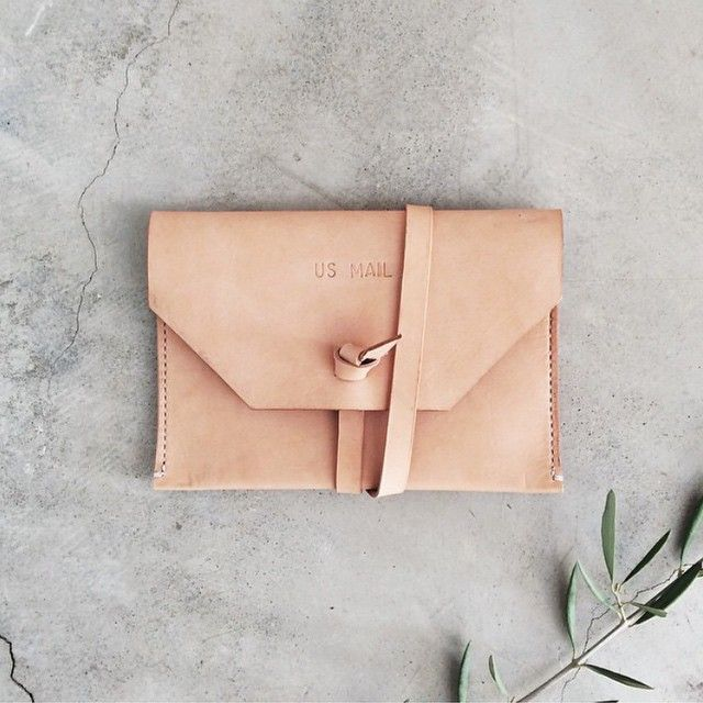 westheritage:Victoria of @paperandtype took this absolutely darling photo of our natural U.S. Mail clutch and we couldn't help but share it. We just restocked a handful of these on the shop!