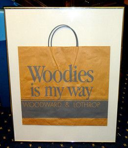 1920's Woodward & Lothrop 'Woodies Is My Way' Department Store Bag in Frame.  For many longtime Washington residents, the Woodward & Lothrop department store, or Woodies as everybody knew it, is a touchstone for memories of easier days and simpler pleasures when Washington was younger. The looming 9-story building at 11th and F Streets, NW, taking up virtually an entire block in the heart of old downtown, served as the stage for many happy moments and a reminder that shopping has long been a…