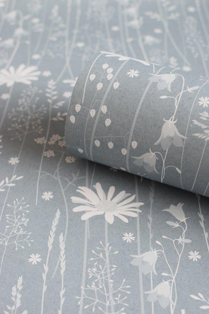 A detail of Daisy meadow wallpaper in moon rise blue by Hannah Nunn #meadow…