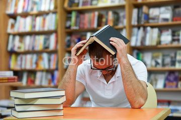Tired man in the library