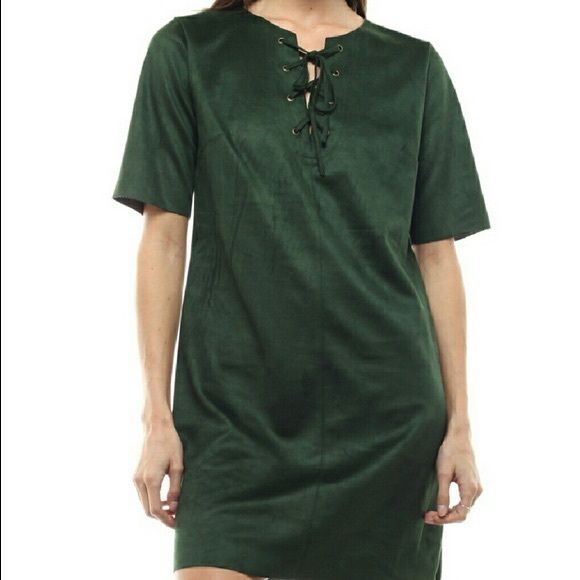 ✨Price Drop! ✨ Hunter Green Suede Dress Lovely green suede dress with laces tying at collar. Sizes: 2 Small, 2 Medium, 1 Large. Medium measures 32 inches from top of shoulders to bottom hem.  Let me know what size you are interested in by leaving it in the comments.  I will make a new listing for you :)  No trades! Moon Collection Dresses