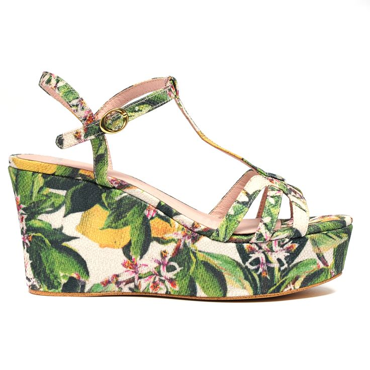 FANCIE by MOLLINI. Embrace summer in these tropical printed wedges. Featuring a sling back and an adjustable buckle strap for your comfort and convenience. Pair with a frock and a sun hat for a feminine chic approach to summer. Heel height is 9cm. Fabric upper, leather lining and man made outsole. #prints #wedges #floral #ss14 #mollini #mollinishoes #love