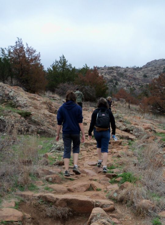 Hiking Elk Mountain Trail - Wichita Mountains, Oklahoma It's about 2 miles roundtrip to the top. Most of the trail is pretty rocky, with natural like steps cut into the trail. See more pictures of the hike.