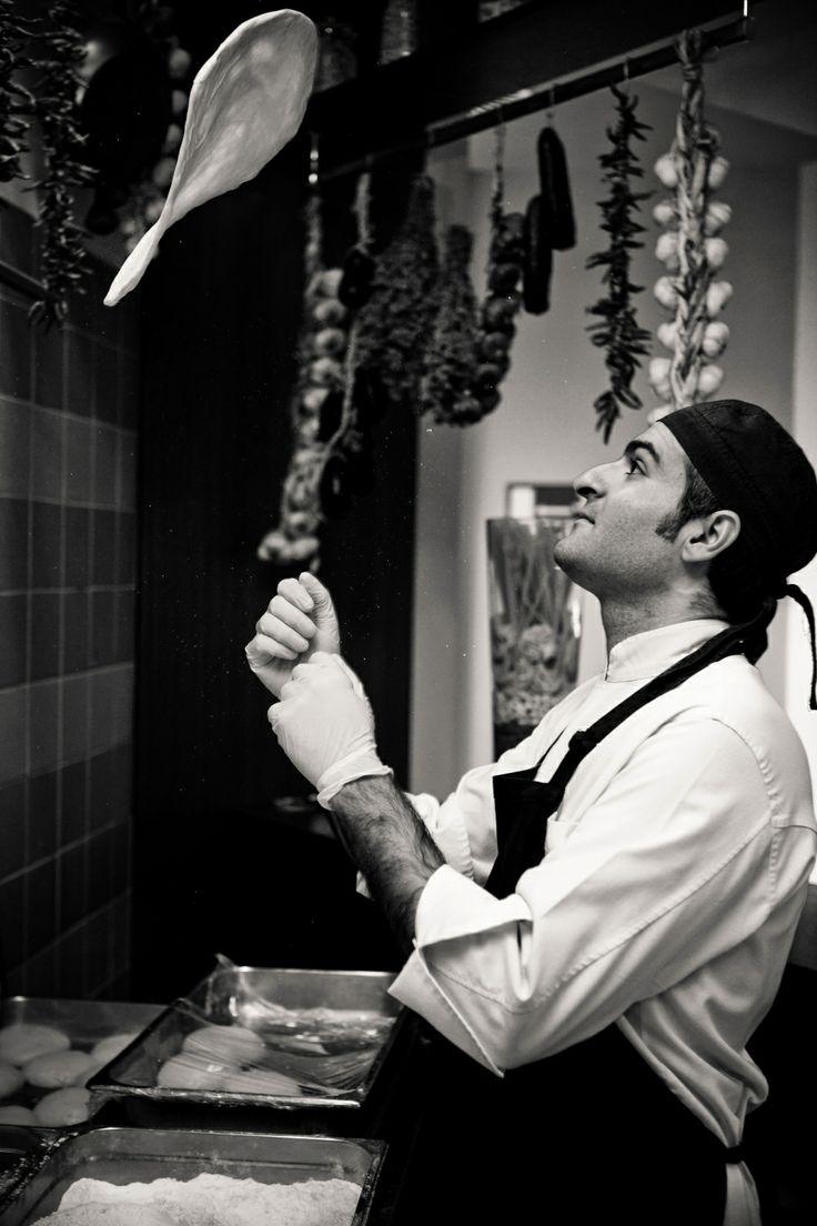 Preparing traditional Italian pizza @ Eataliano
