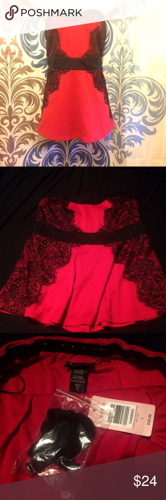 NWT Torrid Size 1 Tank top Very pretty Red with black lace Embellishments. Can be strapless tube top or add the straps and wear as a tank top. Straps are still attached. NWT Torrid size 1 which is 14/16 torrid Tops Tank Tops