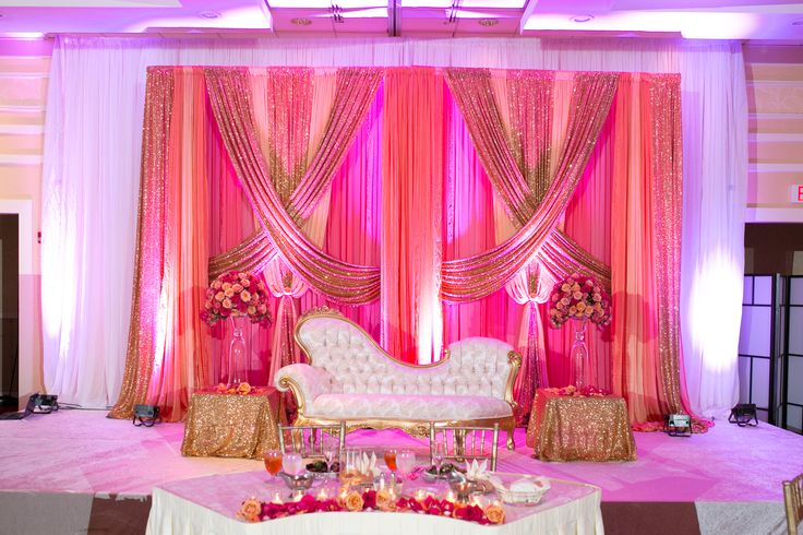 Glowing Reception Stage- coral, pink, and gold drapes #sarahkhaneventstyling