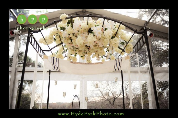 Winter shades of white hydrangea and phalenopsis orchids hang from this chuppa at the Four Seasons Hotel in Downtown Austin, TX. Photo by Austin wedding photographers, Hyde Park Photography. www.HydeParkPhotography.com