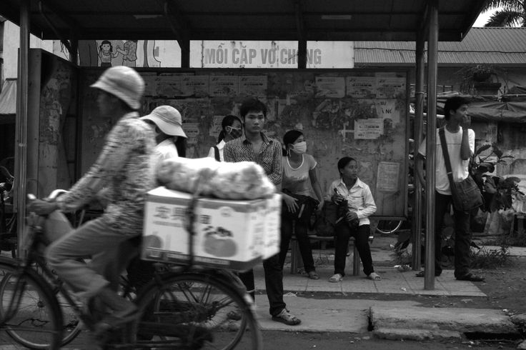 Waiting for the bus in Hanoi