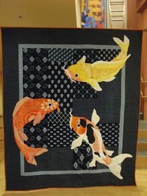 Today the binding and the hanging sleeve were added and the quilt is now hanging in the stairway at the Early Learning Center. This pict...