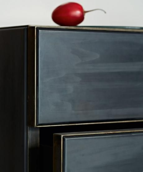 OCHRE Panther chest of drawers - tinted gesso chest with dark tarnished steel plate top, toe kick and edge banding.