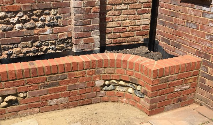 Brick retaining wall with flint panels