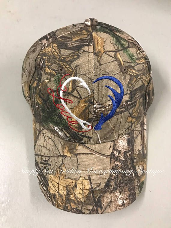 Red, White, & Blue Mossy Oak/Realtree Camo hats with Fishing Hook & Antler Heart shaped Love Embroidery! Licensed Camo, & Structured! One size fits most. Adjustable Backing. I have both Cloth back & Camo Mesh Back. ~Please let me know in notes section if You would like me to use