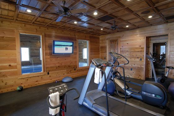 Rustic gym i think that s a pool through the windows