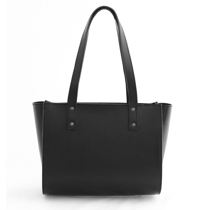 IRMA tote bag is a cool classic that will fit all your essentials and more. Handmade from vegetal tanned soft cow leather. Minimalistic tote bag in black leather.